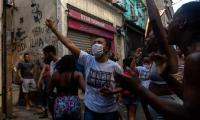 Rio police face fury after bloody raid leading to 25 deaths