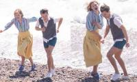Harry Styles and Emma Corrin appear to be real life couple as they enjoy beach walk