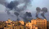 Israel kills 22 Palestinians, including 9 children, in Gaza air strikes