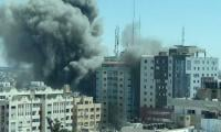 Gaza building containing media offices razed to the ground in Israeli bombing