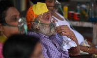India posts record new COVID-19 deaths after data revision