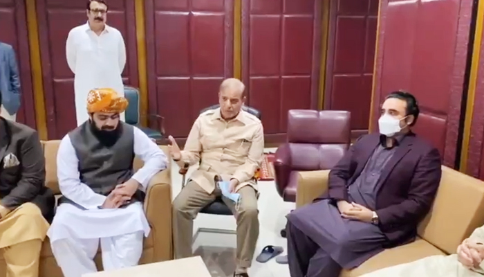 (L to R) JUI-F Leader Asad Mehmood, Opposition Leader in the National Assembly Shehbaz Sharif, and PPP Chairman Bilawal Bhutto meeting in Islamabad, on June 16, 2021. — Still from video shared by PPPs media cell