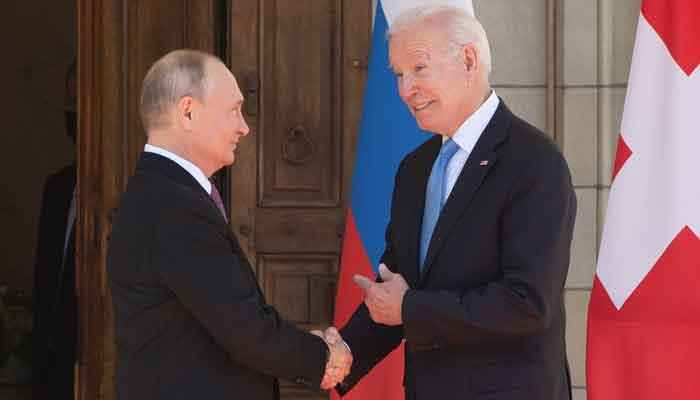 US President Joe Biden and Russian President Vladimir Putin shake hands as they arrive at Villa La Grange in Geneva, for the start of their summit on June 16, 2021. — AFP/Pool/Saul Loeb