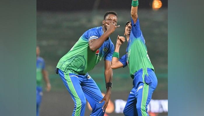 Multan SultansBlessing Muzarabani andShahnawaz Dhani celebrate after dismissing a Quetta Gladiators batsman in Abu Dhabi, on June 16, 2021. — PSL/File
