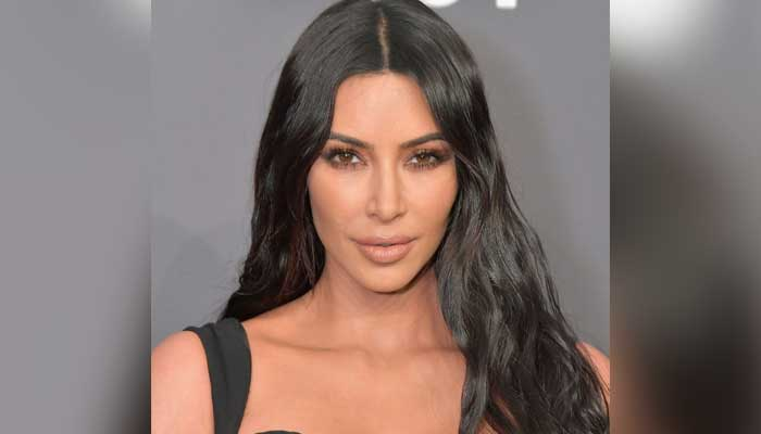 Kim Kardashian weighs in on taking sultry snaps as she becomes lawyer