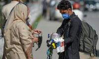 Pakistan reports 1,050 new COVID-19 cases in a single day