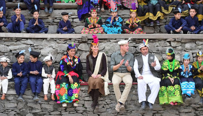 Prince William and Kate Middleton engage with the local public and enjoy festivities while donning traditional clothes