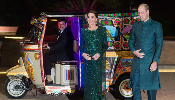 Prince William and Kate Middleton arrive at an event in Islamabad in an auto-rickshaw