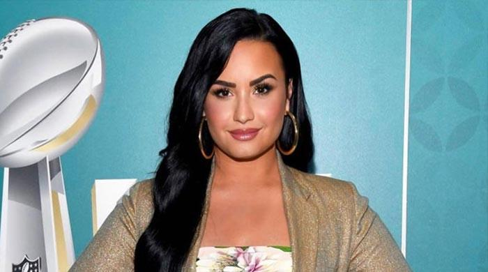 Demi Lovato recalls difficult relationship with father: 'Trying to stay positive'