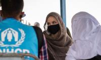 Angelina Jolie, clad in headscarf, talks to refugees in Burkina Faso