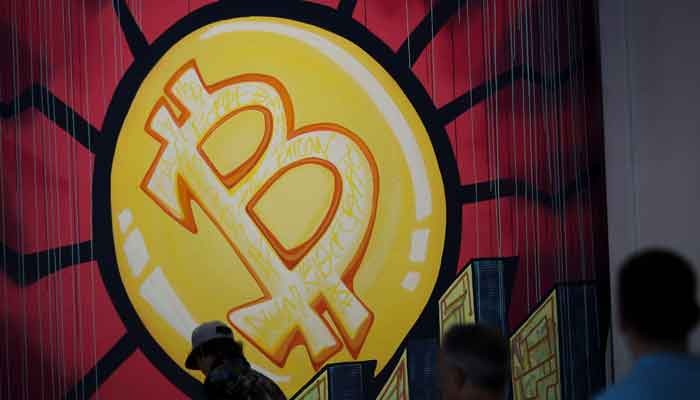 In this file photo taken on June 4, 2021 a banner (designed by artists Stacey Coon, Anastasia Sultzer, and Nanu Berk) with the logo of bitcoin is seen during the crypto-currency conference Bitcoin 2021 Convention at the Mana Convention Center in Miami, Florida. — AFP/Marco Bello