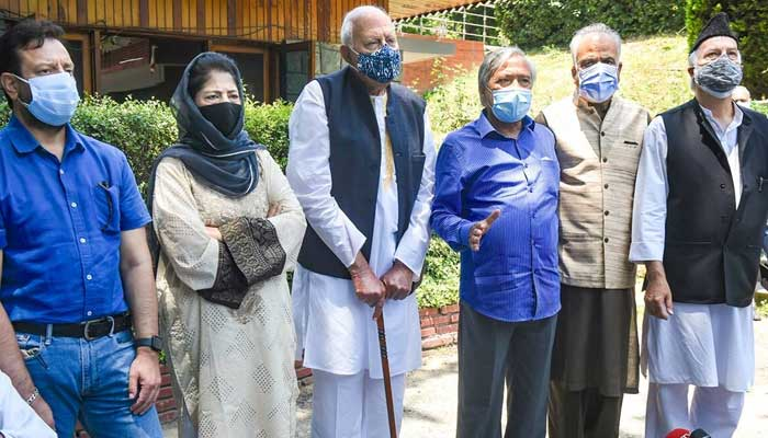 National Conference President Farooq Abdullah, PDP Chief Mehbooba Mufti and other members of the People's Alliance for Gupkar Declaration address the media in Srinagar. -Press Trust of India