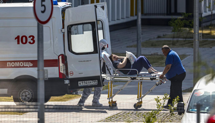 Russia sets new record for Covid deaths as Australia locks down cities