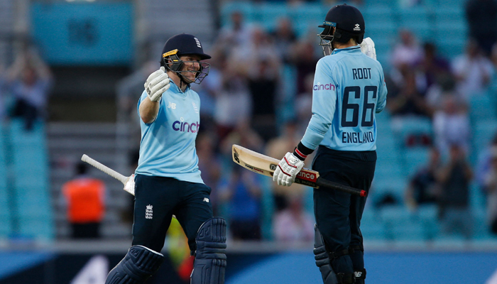 England captain Eoin Morgan (left) and Englishman Joe Root celebrate victory late in the game on International Day 2 (ODI) between England and Sri Lanka at The Oval, south London, on the 1st July 2021. - AFP / File