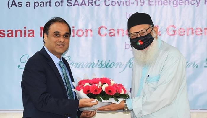 Pakistans High Commissioner Imran Ahmed Siddiqui (left) and President Ahsania Mission Kazi Rafiqul Alam. — Supplied