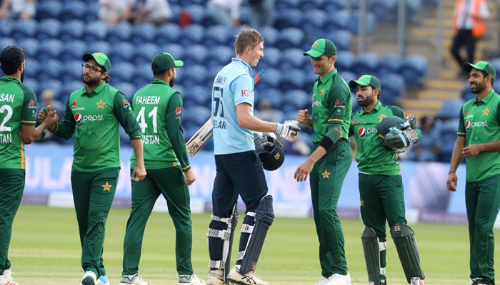 Englands Zak Crawley (L) and Pakistans Shaheen Shah Afridi touch gloves at close of play during the first One Day International cricket match between England and Pakistan at Sophia Gardens stadium in Cardiff, Wales on July 8, 2021. — AFP