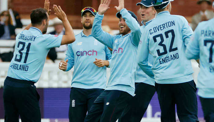Early strike - Englands Lewis Gregory (L) celebrates after dismissing Pakistan opener Imam-ul-Haq for one during the second ODI at Lords on Saturday Tolga Akmen AFP
