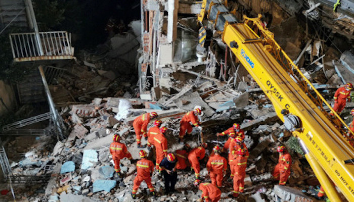 This photo taken on July 12, 2021 shows rescuers searching at the site of a hotel after it collapsed leaving at least 17 dead in the city of Suzhou in Chinas eastern Jiangsu province. Photo: AFP