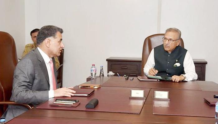 President Dr Arif Alvi being briefed by Director General Inter-Services Intelligence Lt. Gen. Faiz Hamid, on July 15, 2021. — Presidents Secretariat