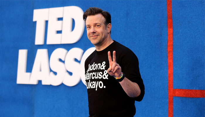 Jason Sudeikis arrived at the premiere of his hit show's second season, rocking a black sweatshirt that honoured the players