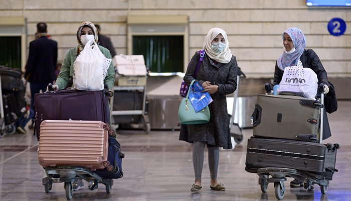 Iraqi passengers returning from Iran wear protective masks at Najaf International Airport on March 5, 2020. — AFP/File