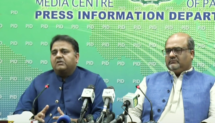 Minister for Information and Broadcasting Fawad Chaudhry (left) along with Adviser to Prime Minister on Interior and Accountability Shahzad Akbar addressing a press conference at Press Information Department in Islamabad, on July 24, 2021. — YouTube/HumNewsLive