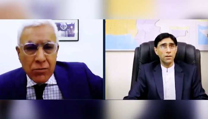 National Security Adviser Moeed Yusuf (right) speaks during an interview with Indian journalist Karan Thapar (left). — The Wire