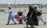 Thousands of Afghan families escape fighting in former Taliban bastion