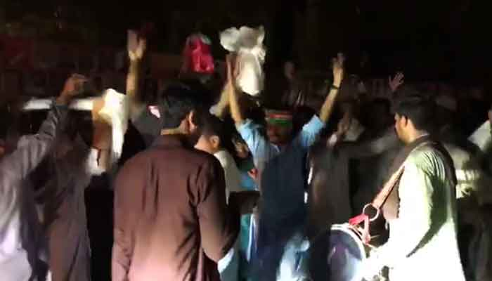 PTI workers celebrate victory in this screengrab from a video shared by PTI on Twitter.