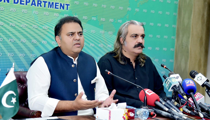 Federal Minister for Information and Broadcasting Fawad Chaudhry (left) addressing a press conference alongside Federal Minister for Kashmir Affairs and Gilgit-Baltistan Ali Amin Gandapur (right) in at PID Islamabad, on July 26, 2021. — PID