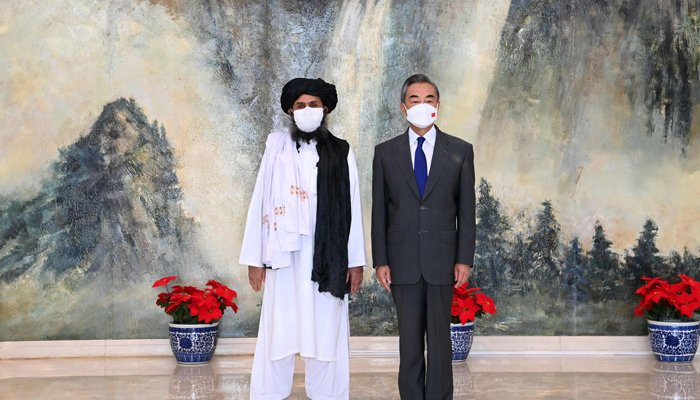 This photo taken on July 28, 2021, and released by China´s Xinhua News Agency shows Chinese State Councilor and Foreign Minister Wang Yi (R) meeting with Mullah Abdul Ghani Baradar, political chief of Afghanistan´s Taliban, in Tianjin. — AFP