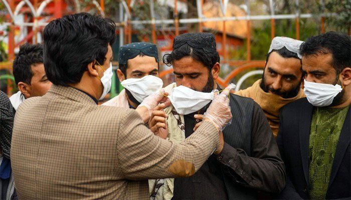 A man teaches how to wear a mask properly. Photo: Files