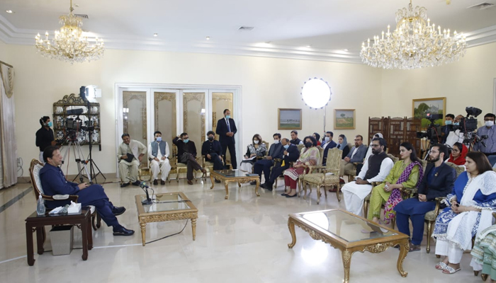 Prime Minister Imran Khan speaking to the Pak Afghan Youth Forum delegation at the PM Office. Photo: Twitter/PM Office