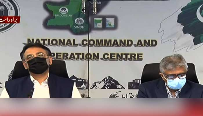 Federal ministers Asad Umar and Dr Faisal Sultan addressing media briefing at NCOC. Screengrab