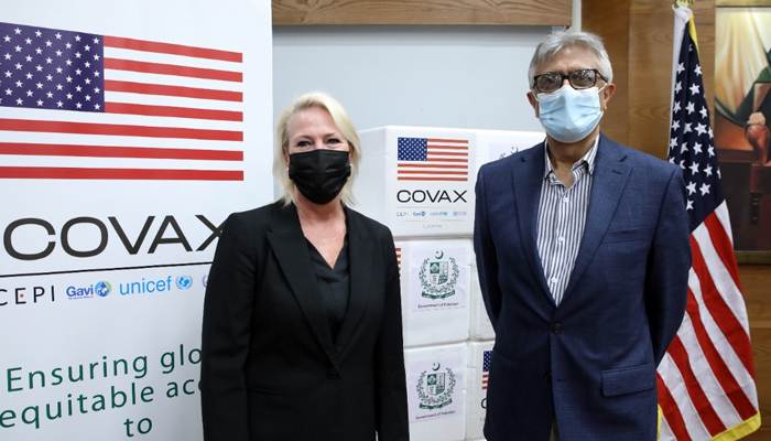 Special Assistant to Prime Minister on Health Dr Faisal Sultan (right) and US Embassy Chargé d'affaires Angela P Aggeler (left) a vaccine handover ceremony on July 29, 2021. — Twitter