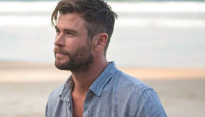 Chris Hemsworth flexes girl-dad skills with 'ultimate family workout' guides