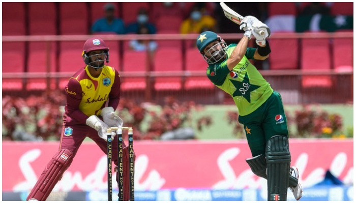 Mohammad Rizwan (R) of Pakistan hits 6 and Nicholas Pooran (L) of the West Indies looks on during the 3rd T20I match between the West Indies and Pakistan at Guyana National Stadium in Providence, Guyana, on July 31, 2021. —AFP