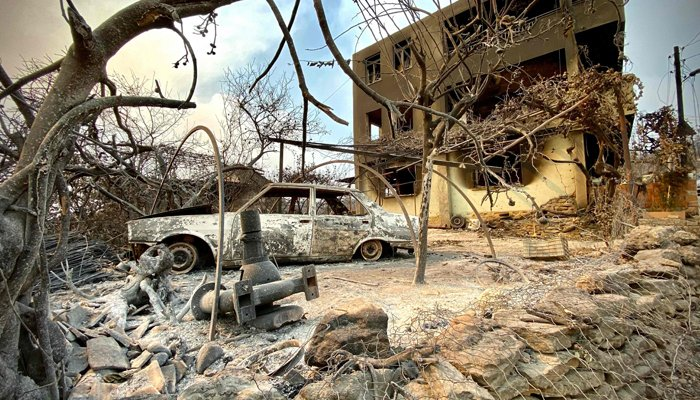This photograph taken on July 31, 2021 near the town of Manavgat shows burnt car in front of a burnt house as a massive forest fire which engulfed a Mediterranean resort region on Turkey´s southern coast. — AFP/File