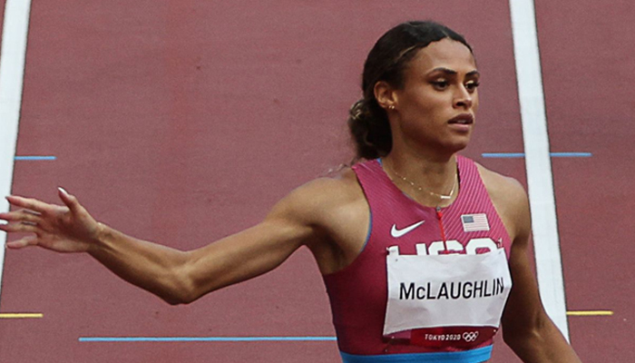 USAs Sydney Mclaughlin wins the women;s 400m hurdles final setting a new world record during the Tokyo 2020 Olympic Games at the Olympic Stadium in Tokyo on August 4, 2021. — AFP