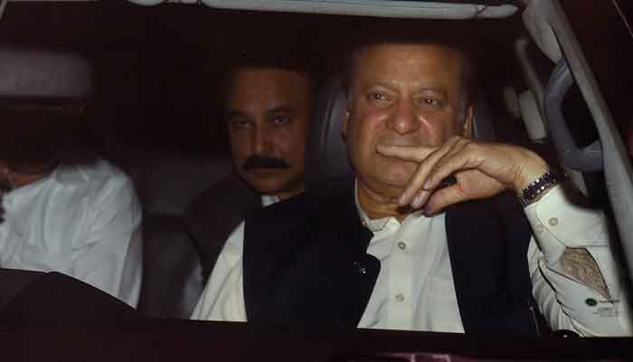Former prime minister Nawaz Sharif, right, leaves Kot Lakhpat jail after his release, in Lahore, on March 27, 2019. — AFP
