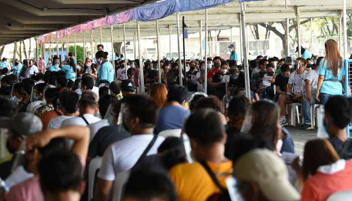 Residents queue for vaccination in Marikina City, suburban Manila on August 6, 2021, as authorities imposed another lockdown to slow the spread of the hyper-contagious Delta variant and ease pressure on hospitals while trying to avoid crushing economic activity. — AFP/File