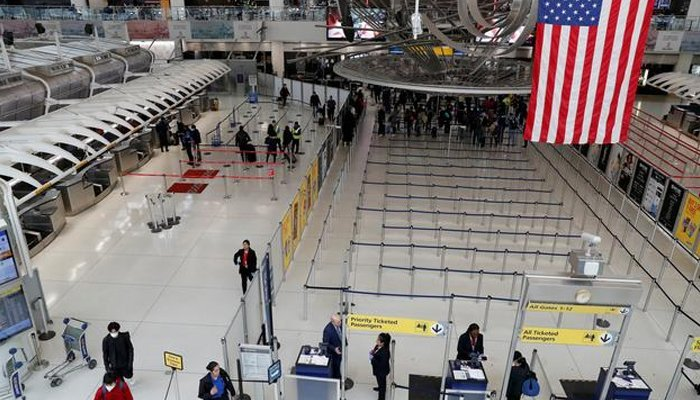 Passengers walk through Terminal 1, after further cases of coronavirus were confirmed in New York, at JFK International Airport in New York, US, on March 13, 2020. — Reuters/File