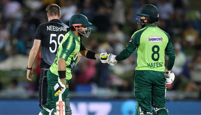 Pakistan batsman Mohammad Rizwan (L) celebrates hitting a six with a teammate Mohammad Hafeez during the third T20 cricket match between New Zealand and Pakistan at McLean Park on December 22, 2020. — AFP/File