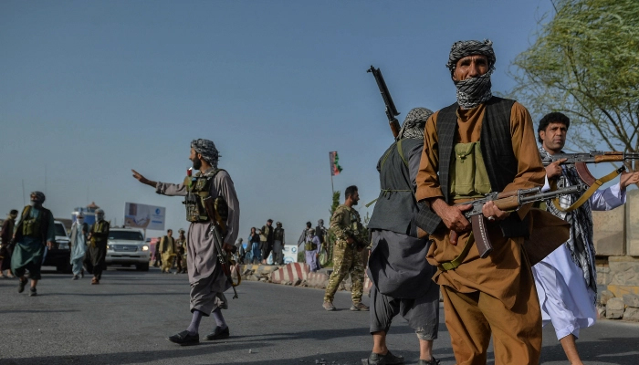 Afghan security personnel and Afghan militia fighting against Taliban, stand guard in Enjil district of Herat province. — AFP/File