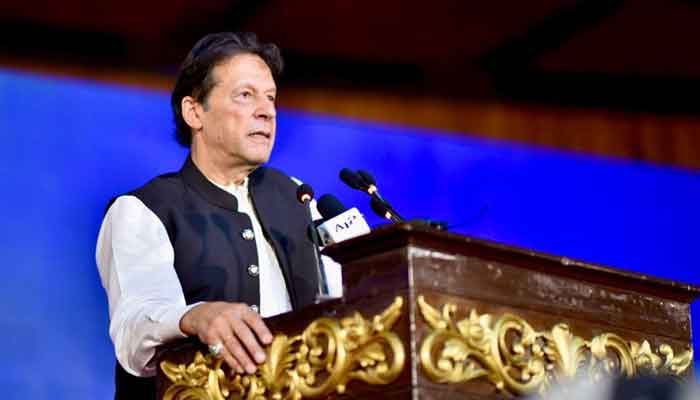 Prime Minister Imran Khan addressing a ceremony at Islamabads Convention Centre to unveil PTIs performance over the last three years, on August 26, 2021. — PID