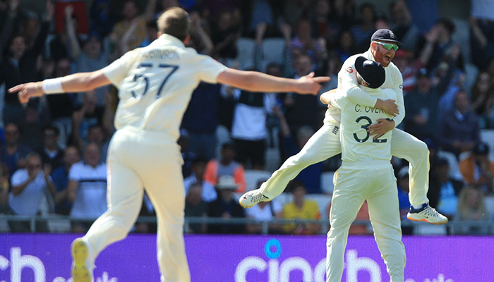 England´s Jonny Bairstow leaps into the arms of England´s Craig Overton after Overton takes the catch to dismiss India´s Rishabh Pant off the bowling of England´s Ollie Robinson (L) for 1 run on the fourth day of the third cricket Test match between England and India at Headingley cricket ground in Leeds, northern England, on August 28, 2021. — AFP
