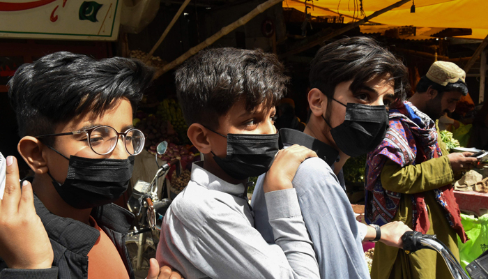 Residents wear protective facemasks as a prevention measure against the COVID-19 coronavirus at a market in Quetta on February 27, 2020. — Photo: AFP