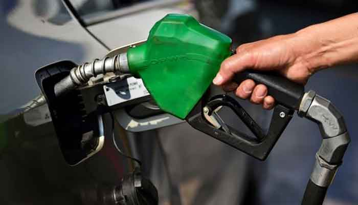 Petrol being filled in a car. — AFP/File