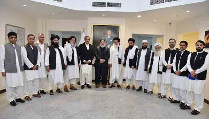A Taliban delegation with Pakistani envoy in Doha.
