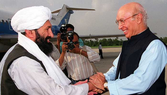 In this file photo taken on August 25, 1999 Pakistani Foreign Minister Sartaj Aziz receives his Afghan Taliban counterpart Mullah Mohammad Hassan Akhund (L) at an Air Force base in Rawalpindi, some 25 kilometres from Islamabad. — AFP